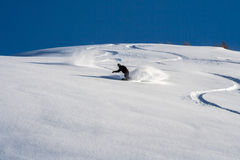 Snowboarder go down on powder snow. Stock Image