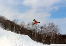 Snowboarder going off a big jump in hanazono park Royalty Free Stock Photography