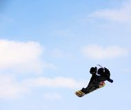 Snowboarder  going off a big jump in hanazono park Royalty Free Stock Images