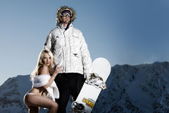 Snowboarder with groupie girl Royalty Free Stock Photos