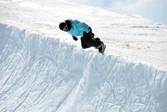 Snowboarder in Half pipe Stock Images