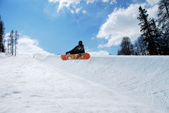 Snowboarder in Half pipe. Snowboarder jump in a half-pipe Royalty Free Stock Photography