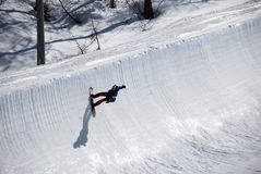Snowboarder on half pipe trail. A snowboarder does a trick at the half pipe at Valmalenco - Italy Royalty Free Stock Photos