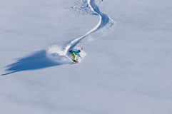 Snowboarder having fun in deep backcountry snow Royalty Free Stock Image