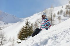 Snowboarder having a rest Stock Image