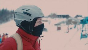 Snowboarder in helmet and a red jacket stock video footage