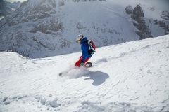 Snowboarder in high mountains Stock Images
