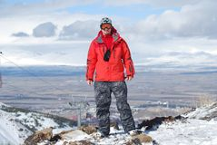 Snowboarder high up in the mountains Stock Image