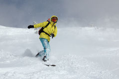 Snowboarder on the hill stock photography