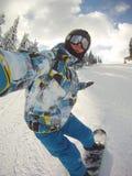Snowboarder im Aktionsselbstporträt Stockbilder