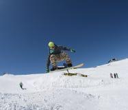 Snowboarder im Park Stockfoto