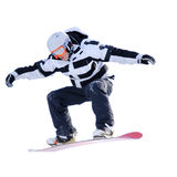 Snowboarder isolated on white. Snowboarder sails through the air; image isolated on white background Royalty Free Stock Image