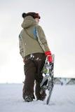 Snowboarder joven de la hembra adulta imagenes de archivo