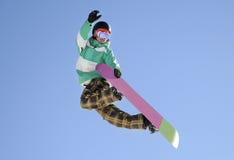 Snowboarder jump Stock Photo
