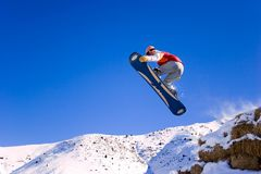 Snowboarder is in jump royalty free stock image