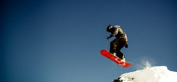Snowboarder jump royalty free stock photos
