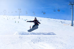 Snowboarder at jump inhigh mountains Royalty Free Stock Images