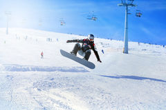 Snowboarder at jump inhigh mountains Royalty Free Stock Photography
