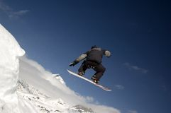 Snowboarder jumping. High in the air Royalty Free Stock Image