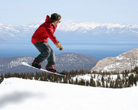 Snowboarder jumping. With a beautiful view Stock Photos