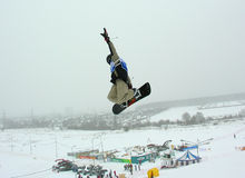 Snowboarder jumping. Above ground royalty free stock image