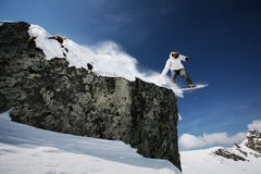 Snowboarder jumping. High in the air Royalty Free Stock Photos