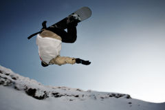 Snowboarder jumping. High in the air and performing a 360 degree rotation Stock Images
