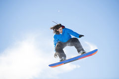 Snowboarder jumping against Stock Images