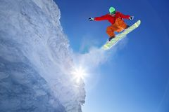 Free Snowboarder Jumping Against Blue Sky Royalty Free Stock Photo - 101221775
