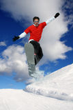Snowboarder jumping against blue sky Royalty Free Stock Photography