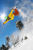 Snowboarder jumping against blue sky Stock Images