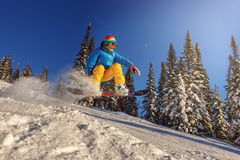 Snowboarder jumping against blue sky Royalty Free Stock Images