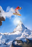 Snowboarder jumping against Matterhorn peak in Switzerland Royalty Free Stock Photography
