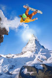 Snowboarder jumping against Matterhorn peak in Switzerland Stock Images