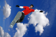Snowboarder jumping against sky Royalty Free Stock Image