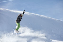 Snowboarder jumping against snow slope background. Young snowboarder jumping against snow slope background Stock Photos