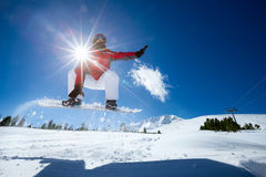 Snowboarder jumping in air Stock Photography
