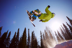 Snowboarder jumping Royalty Free Stock Photo