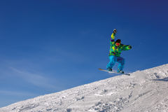 Snowboarder jumping Stock Photography