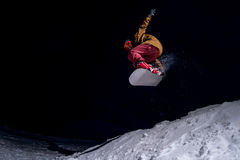 Snowboarder jumping. On the air at night Royalty Free Stock Photos