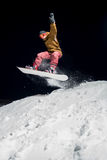 Snowboarder jumping. In the air at night Stock Photos