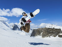 Snowboarder jumping on background of mountains Stock Image