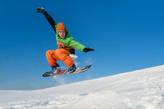 Snowboarder jumping blue sky in background Stock Photography