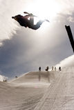 Snowboarder Jumping in Halfpipe. Snowboarder jumping back side at high speed in the super-pipe Breckenridge, Colorado Royalty Free Stock Image