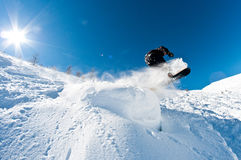 Snowboarder jumping. And having great fun Royalty Free Stock Photo