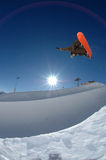 Snowboarder jumping high Stock Image