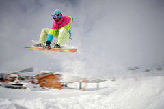 Snowboarder jumping high. Image of snowboarder jumping in Alpe D Huez, France Stock Photography
