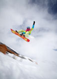 Snowboarder jumping high. Image of snowboarder jumping in Alpe D Huez, France Royalty Free Stock Image