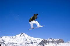 Snowboarder jumping high in the air Royalty Free Stock Photo