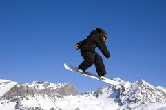 Snowboarder jumping high in the air Royalty Free Stock Photography